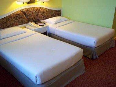 Bedroom at the Wang Tai Hotel