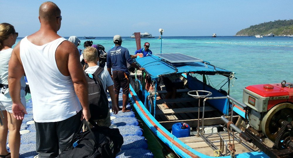 Boarding a longtail boat to Koh Lipe Floating Pier