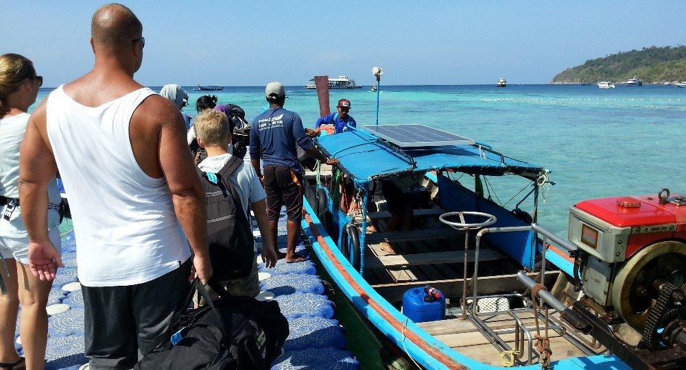 Boarding a longtail boat to Koh Lipe Floating Pier