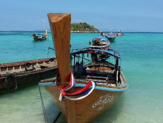 Longtail boats on Sunrise Beach