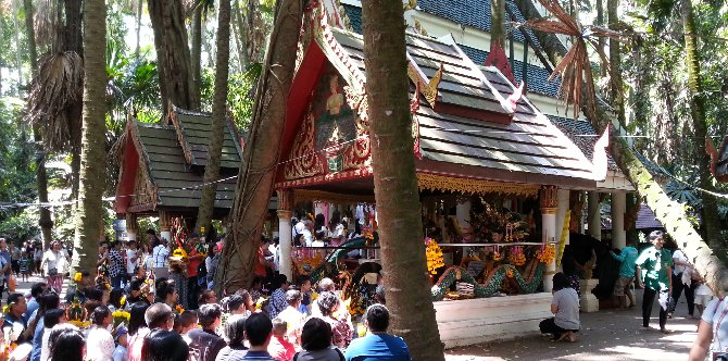 Prayer at the shrines in Wat Kham Chanot Forest